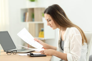 woman-looking-over-paperwork